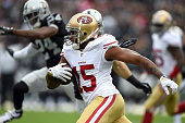 Michael Crabtree of the San Francisco 49ers carries in the first quarter against the Oakland Raiders at Oco Coliseum on December 7 2014 in Oakland...