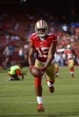 Michael Crabtree of the San Francisco 49ers catches a pass in pregame warm ups before their game against the Detroit Lions at Candlestick Park on...