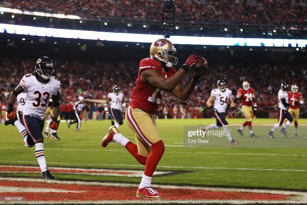 <a gi-track='captionPersonalityLinkClicked' href=/galleries/search?phrase=Michael+Crabtree&family=editorial&specificpeople=4650635 ng-click='$event.stopPropagation()'>Michael Crabtree</a> #15 of the San Francisco 49ers catches a third quarter touchdown pass against the Chicago Bears at Candlestick Park on November 19, 2012 in San Francisco, California.