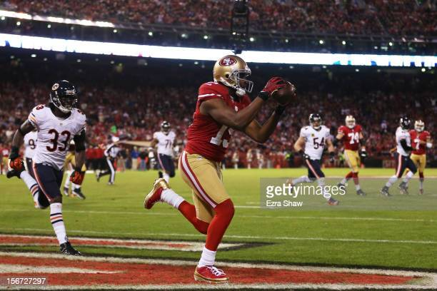 Michael Crabtree of the San Francisco 49ers catches a third quarter touchdown pass against the Chicago Bears at Candlestick Park on November 19 2012...