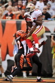 Michael Crabtree of the San Francisco 49ers catches an apparent touchdown pass over the defense of Chris Crocker of the Cincinnati Bengals and Leon...