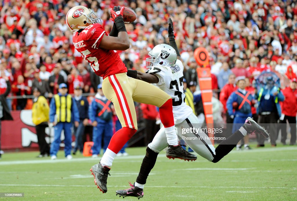 Michael Crabtree #15 of the San Francisco 49ers catches this touchdown pass over Chris Johnson #37 of the Oakland Raiders during an NFL football game at Candlestick Park October 17, 2010 in San Francisco, California. The 49ers won the game 17-9.