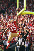 Michael Crabtree of the San Francisco 49ers celebrates after scoring a touchdown in the first quarter against the New Orleans Saints during the NFC...
