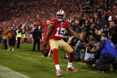 Michael Crabtree of the San Francisco 49ers celebrates catching a third quarter touchdown pass against the Chicago Bears at Candlestick Park on...