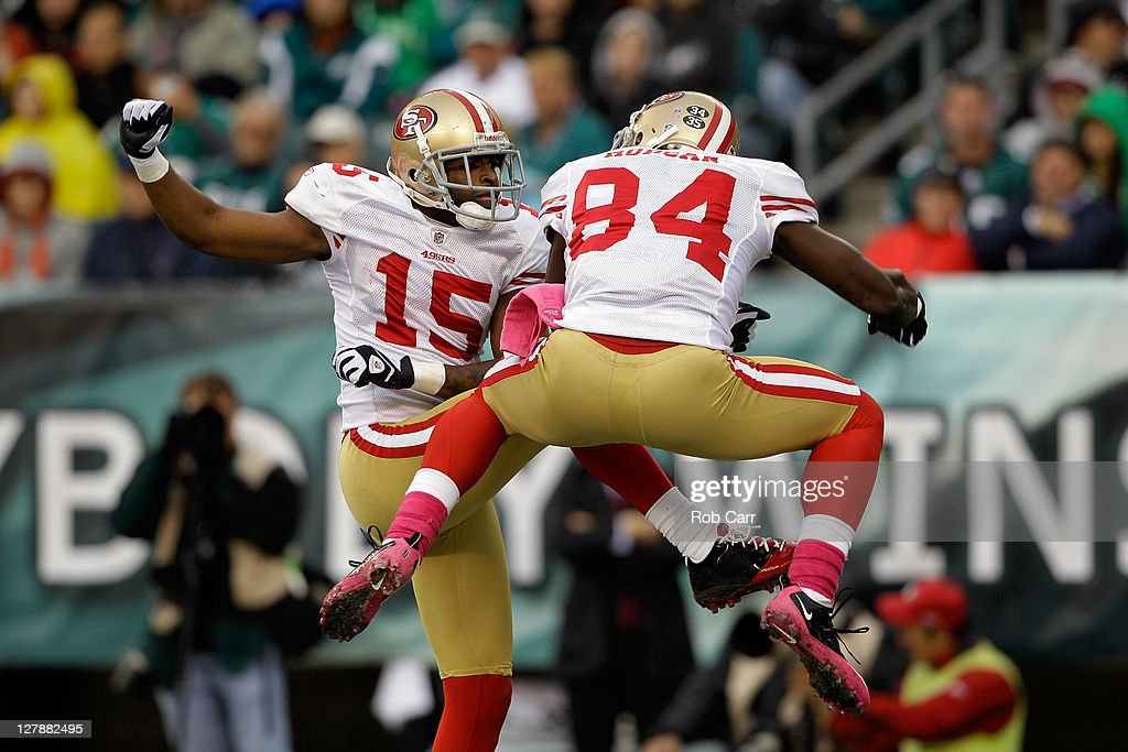 Michael Crabtree of the San Francisco 49ers celebrates with teammate Josh Morgan after Morgan scored a touchdown against the Philadelphia Eagles...