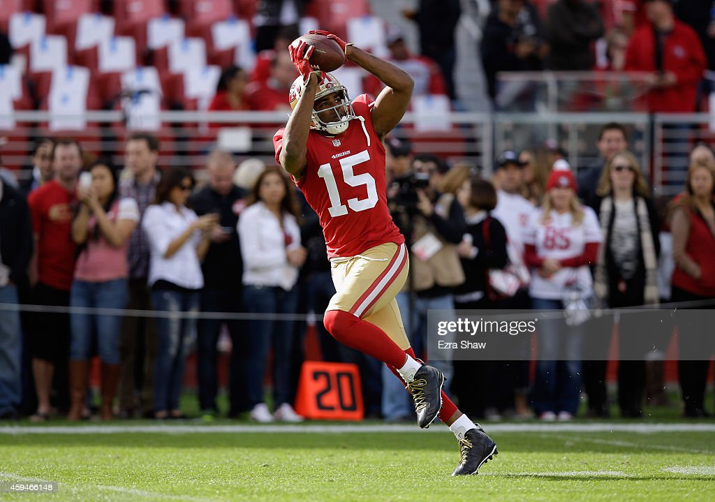 Michael Crabtree of the San Francisco 49ers completes a pass during warm ups against the Washington Redskins at Levi's Stadium on November 23 2014 in...
