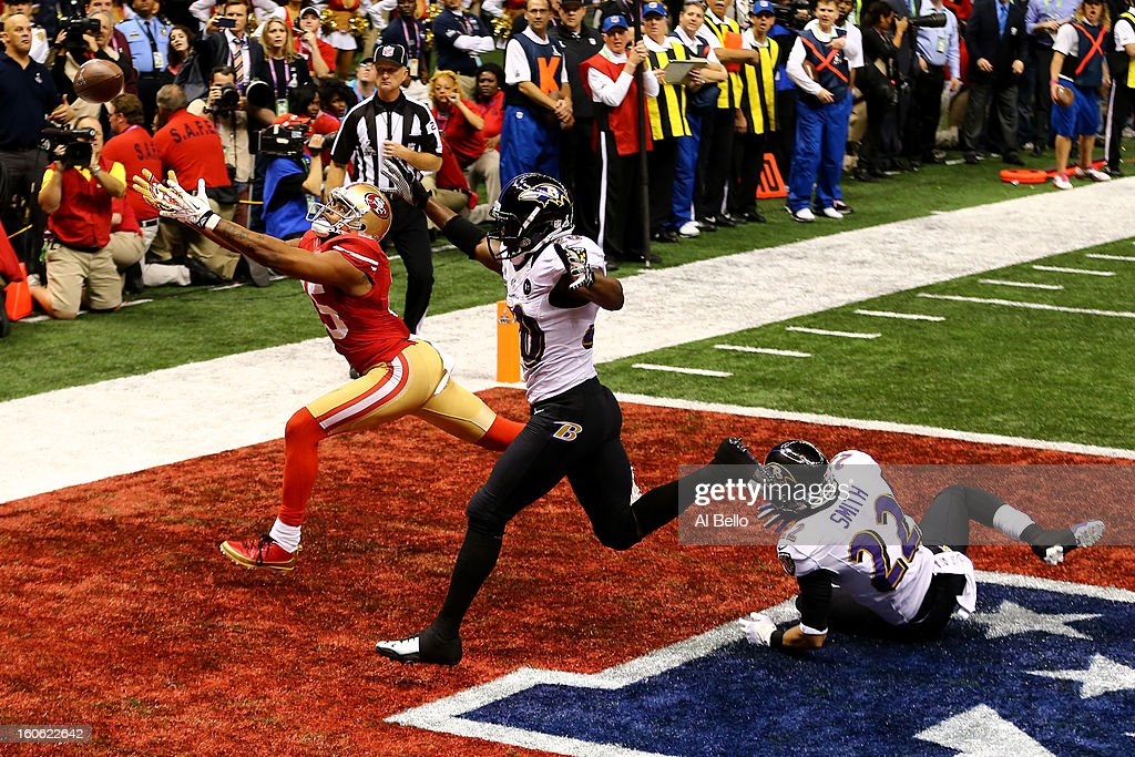 Michael Crabtree of the San Francisco 49ers fails to make a catch in the endzone late in the fourth quarter against Ed Reed of the Baltimore Ravens...