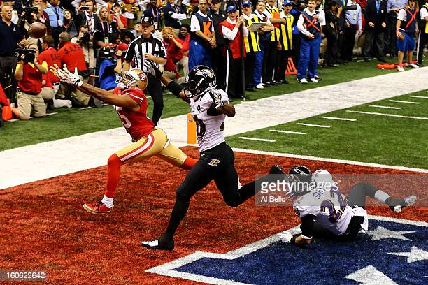 Michael Crabtree of the San Francisco 49ers fails to make a catch in the end zone late in the fourth quarter against Ed Reed of the Baltimore Ravens...