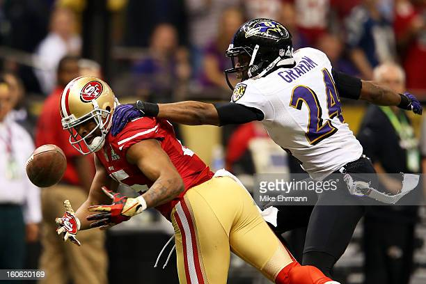 Michael Crabtree of the San Francisco 49ers fails to make a catch against Corey Graham of the Baltimore Ravens during Super Bowl XLVII at the...