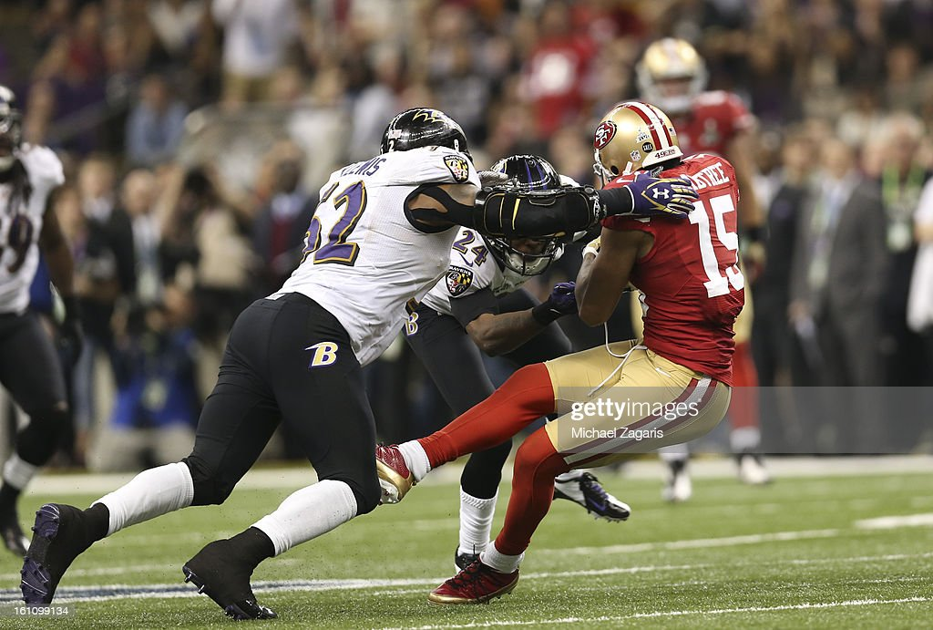 Michael Crabtree #15 of the San Francisco 49ers gets hit by Ray Lewis #52 of the Baltimore Ravens after making a reception during Super Bowl XLVII at the Mercedes-Benz Superdome on February 3, 2013 in New Orleans, Louisiana. The Ravens won 34-31.