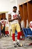 Michael Crabtree of the San Francisco 49ers listens to music in the locker room prior to the game against the St Louis Rams at the Edward Jones Dome...