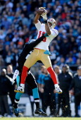 Michael Crabtree of the San Francisco 49ers makes a catch in the second quarter against the Carolina Panthers during the NFC Divisional Playoff Game...