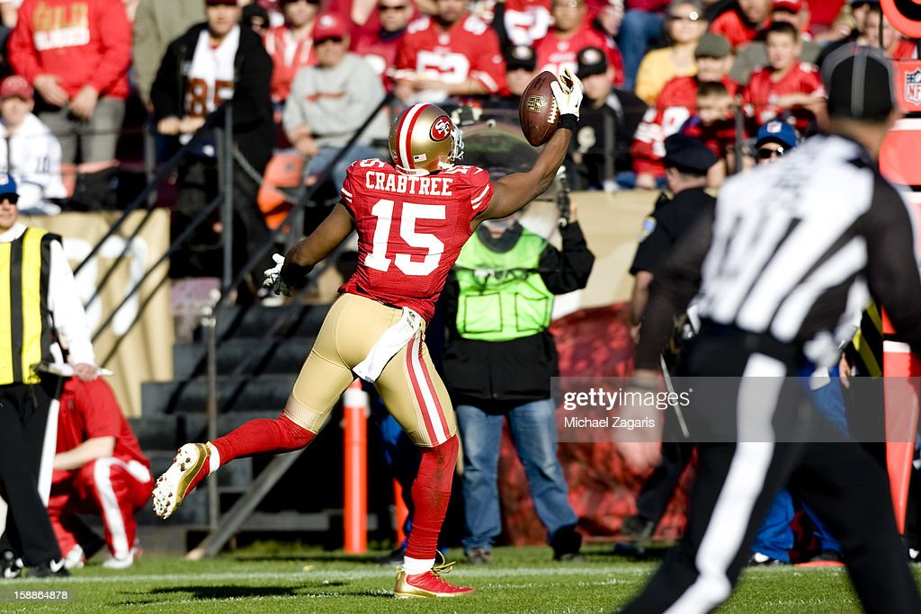 Michael Crabtree #15 of the San Francisco 49ers makes a one-handed catch during the game against the Arizona Cardinals at Candlestick Park on December 30, 2012 in San Francisco, California. The 49ers defeated the Cardinals 27-13.