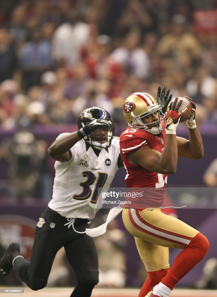 Michael Crabtree #15 of the San Francisco 49ers makes a reception against the Baltimore Ravens during Super Bowl XLVII at the Mercedes-Benz Superdome on February 3, 2013 in New Orleans, Louisiana. The Ravens won 34-31.