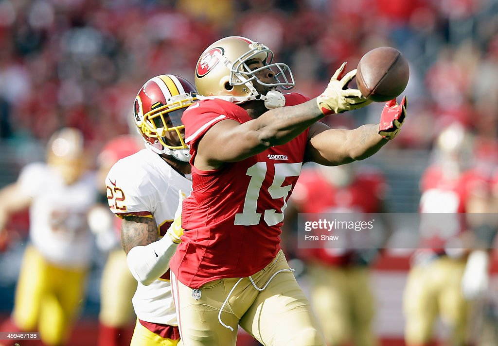 Michael Crabtree #15 of the San Francisco 49ers misses a pass in front of Tracy Porter #22 of the Washington Redskins at Levi's Stadium on November 23, 2014 in Santa Clara, California.