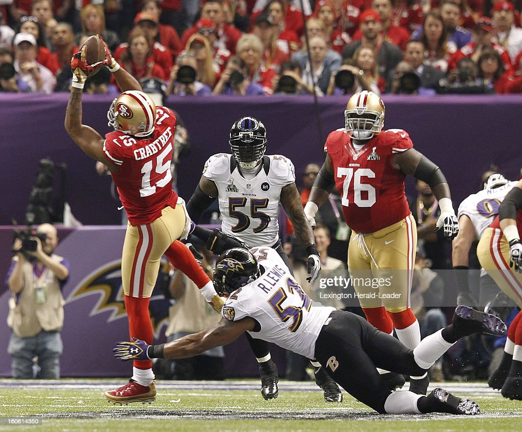 Michael Crabtree (15) of the San Francisco 49ers pulls in a pass against Ray Lewis (52) of the Baltimore Ravens during first-half action in Super Bowl XLVII at the Mercedes-Benz Superdome in New Orleans, Louisiana, Sunday, February 3, 2013.