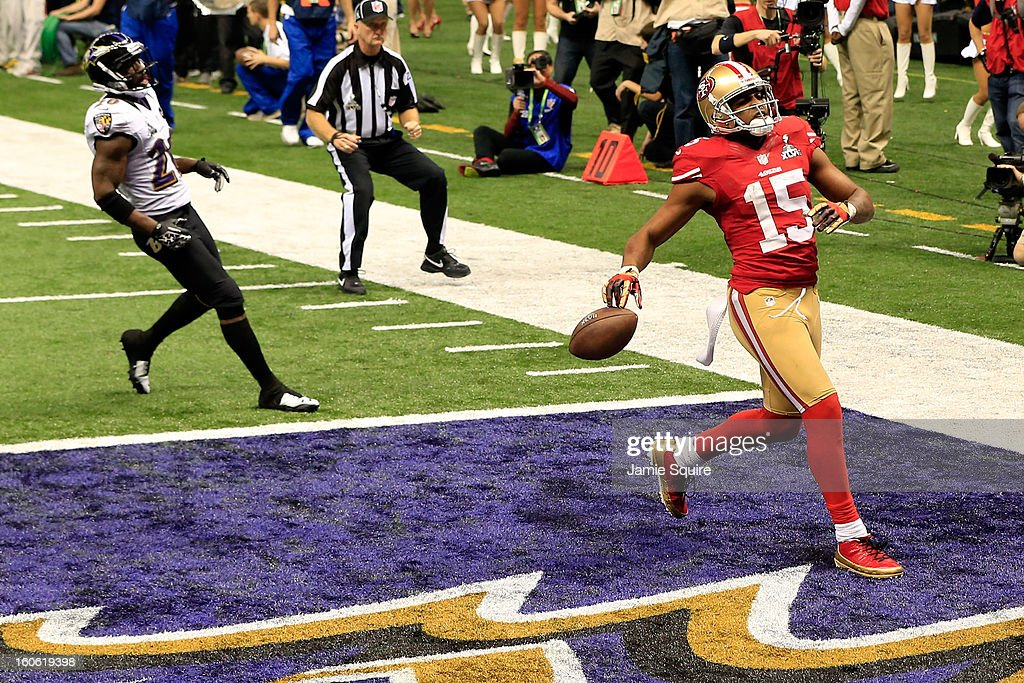 Michael Crabtree #15 of the San Francisco 49ers reacts after running in for a touchdown in the third quarter against the Baltimore Ravens during Super Bowl XLVII at the Mercedes-Benz Superdome on February 3, 2013 in New Orleans, Louisiana.