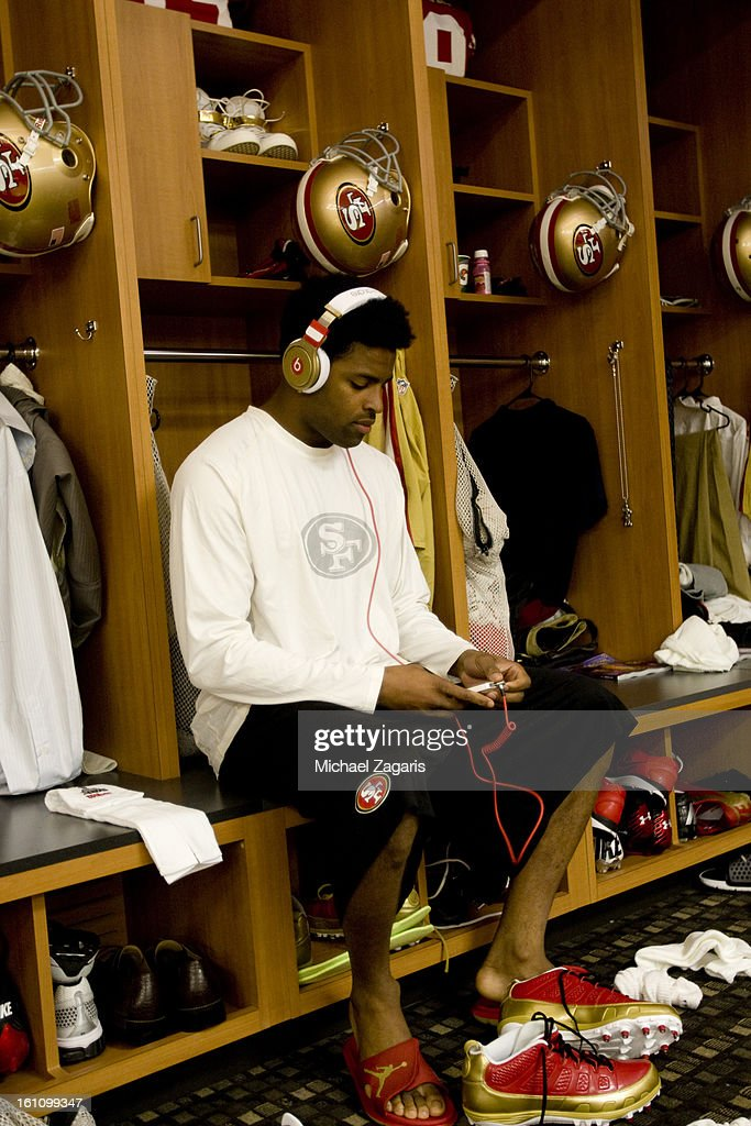 Michael Crabtree #15 of the San Francisco 49ers relaxes in the locker room prior to Super Bowl XLVII against the Baltimore Ravens at the Mercedes-Benz Superdome on February 3, 2013 in New Orleans, Louisiana. The Ravens won 34-31.