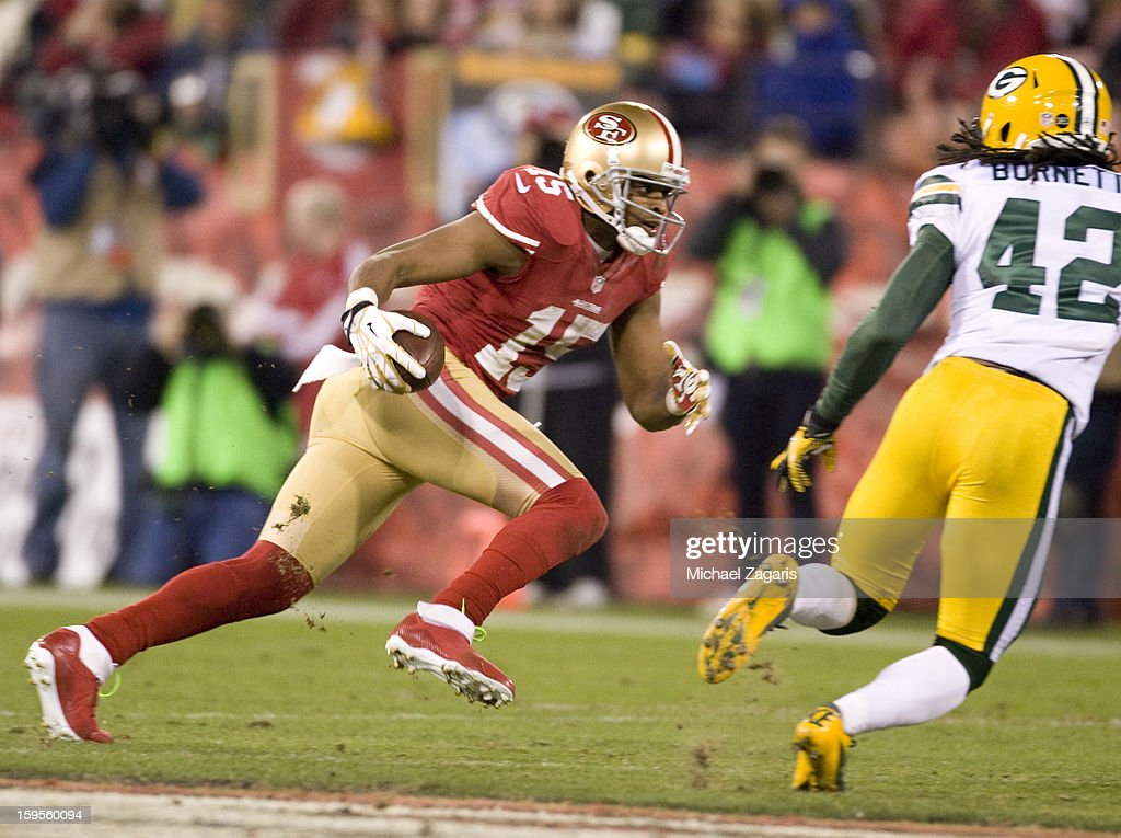 Michael Crabtree #15 of the San Francisco 49ers runs after making a reception during the game against the Green Bay Packers at Candlestick Park on January 12, 2012 in San Francisco, California. The 49ers defeated the Packers 45-31.