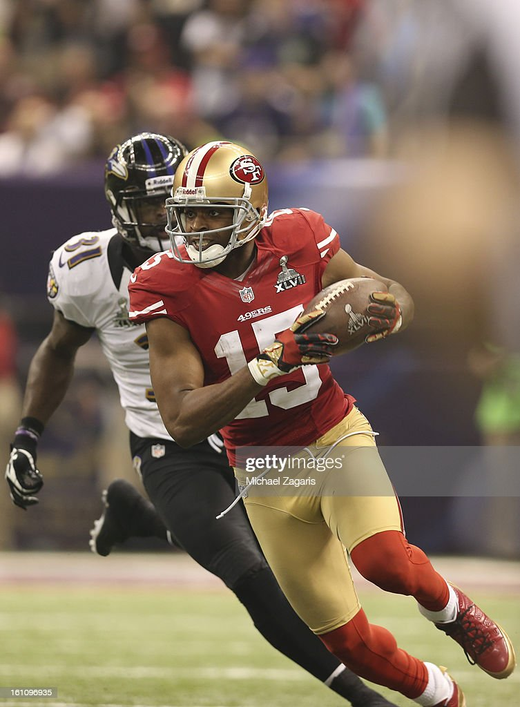 Michael Crabtree #15 of the San Francisco 49ers runs after making a reception against the Baltimore Ravens during Super Bowl XLVII at the Mercedes-Benz Superdome on February 3, 2013 in New Orleans, Louisiana. The Ravens won 34-31.
