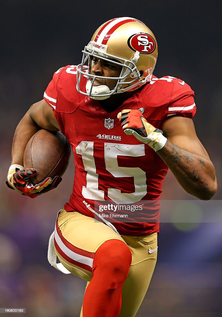 <a gi-track='captionPersonalityLinkClicked' href=/galleries/search?phrase=Michael+Crabtree&family=editorial&specificpeople=4650635 ng-click='$event.stopPropagation()'>Michael Crabtree</a> #15 of the San Francisco 49ers runs in for a touchdown in the second half against the Baltimore Ravens during Super Bowl XLVII at the Mercedes-Benz Superdome on February 3, 2013 in New Orleans, Louisiana.