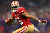 Michael Crabtree of the San Francisco 49ers runs in for a touchdown in the second half against the Baltimore Ravens during Super Bowl XLVII at the...