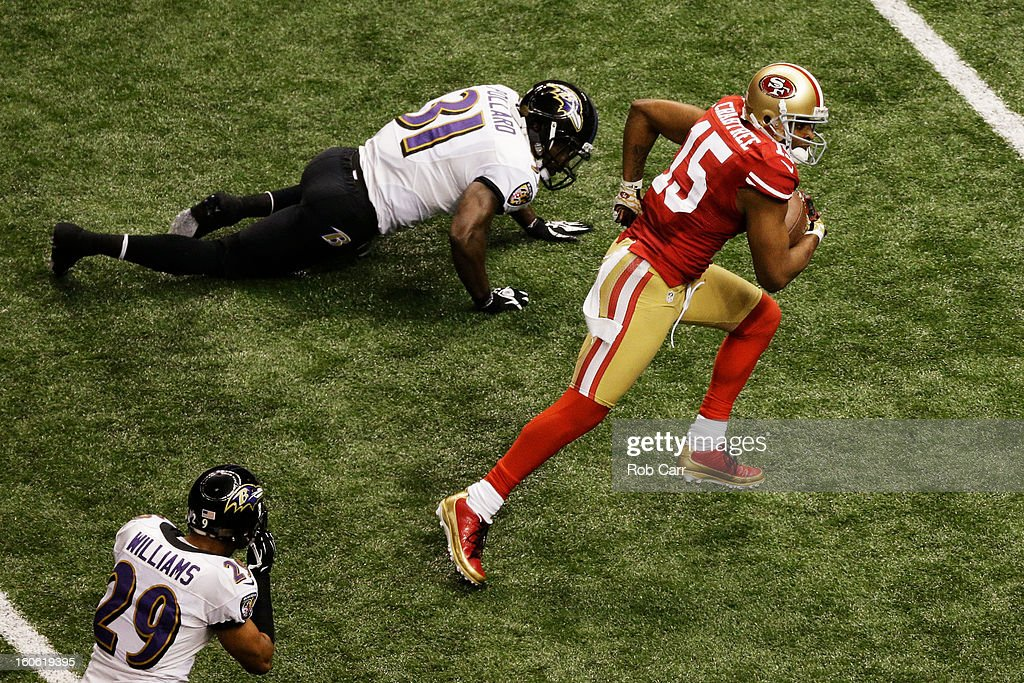 Michael Crabtree #15 of the San Francisco 49ers runs into the endzone on a 31-yard touchdown reception in the third quarter against Bernard Pollard #31 of the Baltimore Ravens during Super Bowl XLVII at the Mercedes-Benz Superdome on February 3, 2013 in New Orleans, Louisiana.