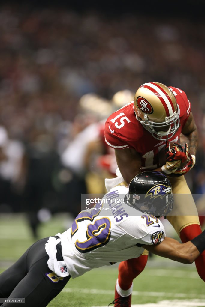 Michael Crabtree #15 of the San Francisco 49ers runs the ball to the end zone on a 31-yard pass play against the Baltimore Ravens during Super Bowl XLVII at the Mercedes-Benz Superdome on February 3, 2013 in New Orleans, Louisiana. The Ravens won 34-31.