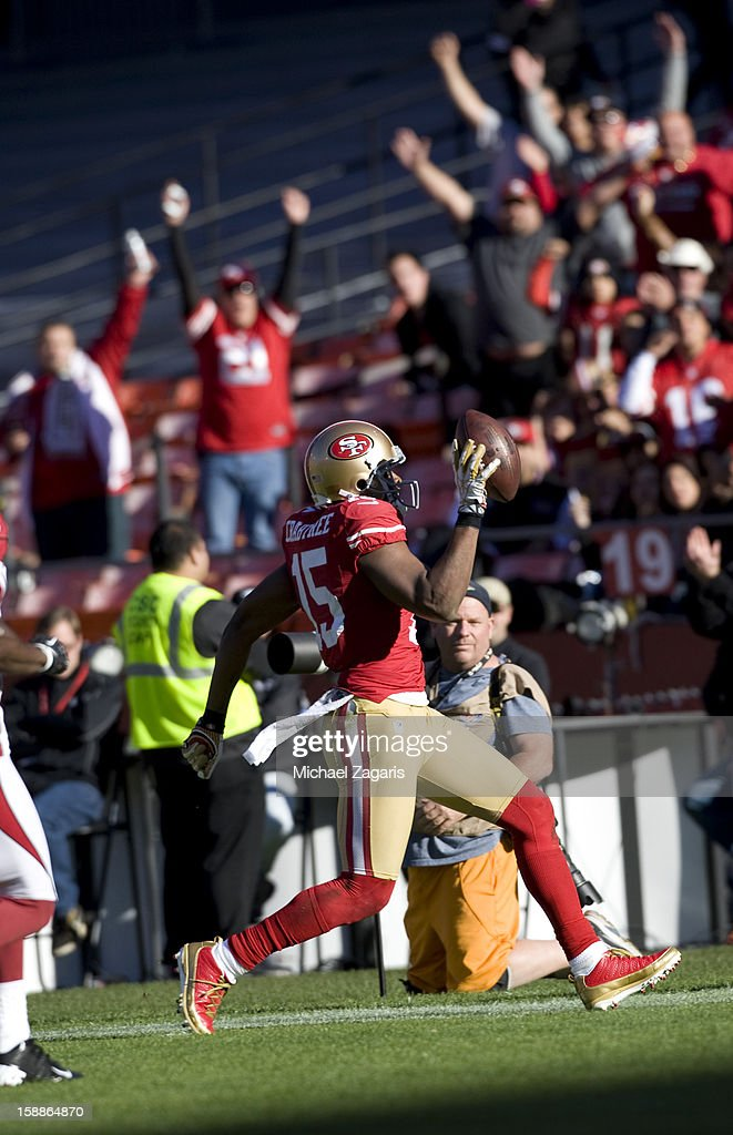Michael Crabtree #15 of the San Francisco 49ers runs the endzone on a 49-yard touchdown pass during the game against the Arizona Cardinals at Candlestick Park on December 30, 2012 in San Francisco, California. The 49ers defeated the Cardinals 27-13.
