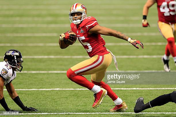 Michael Crabtree of the San Francisco 49ers runs with the ball before scoring a touchdown in front of Cary Williams of the Baltimore Ravens in the...