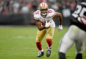 Michael Crabtree of the San Francisco 49ers runs with the ball against the Oakland Raiders in the third quarter at Oco Coliseum on December 7 2014 in...