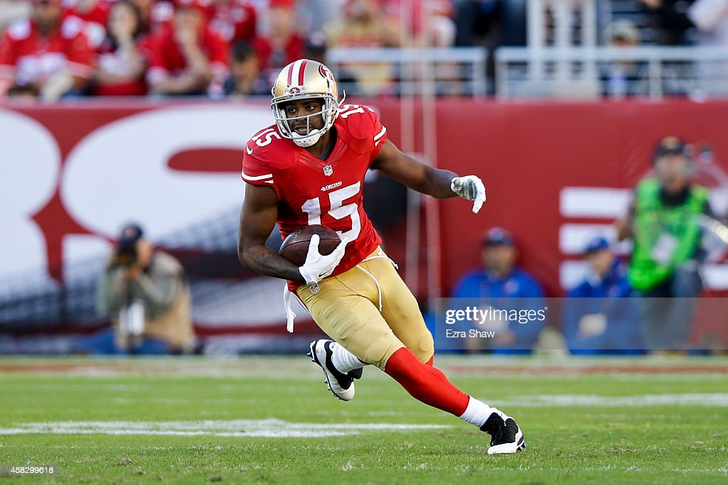 Michael Crabtree of the San Francisco 49ers rushes up field after a pass reception against the St Louis Rams during the third quarter at Levi's...