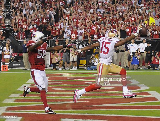 Michael Crabtree of the San Francisco 49ers scores a touchdown in front of Daryl Washington of the Arizona Cardinals at University of Phoenix Stadium...
