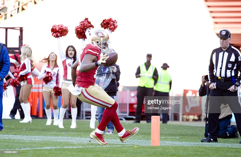 Michael Crabtree #15 of the San Francisco 49ers scores on a 5-yard touchdown pass reception during the game against the Arizona Cardinals at Candlestick Park on December 30, 2012 in San Francisco, California. The 49ers defeated the Cardinals 27-13.