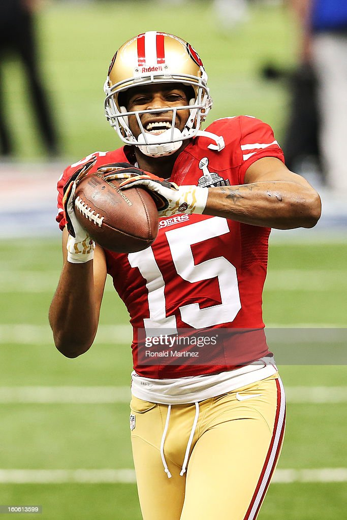 Michael Crabtree #15 of the San Francisco 49ers warms up against the Baltimore Ravens during Super Bowl XLVII at the Mercedes-Benz Superdome on February 3, 2013 in New Orleans, Louisiana.