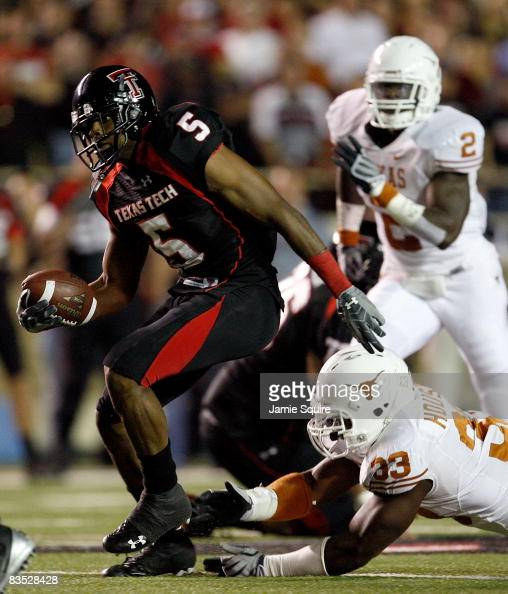 Michael Crabtree of the Texas Tech Red Raiders carries the ball after making a reception during the first half of the game against the Texas...