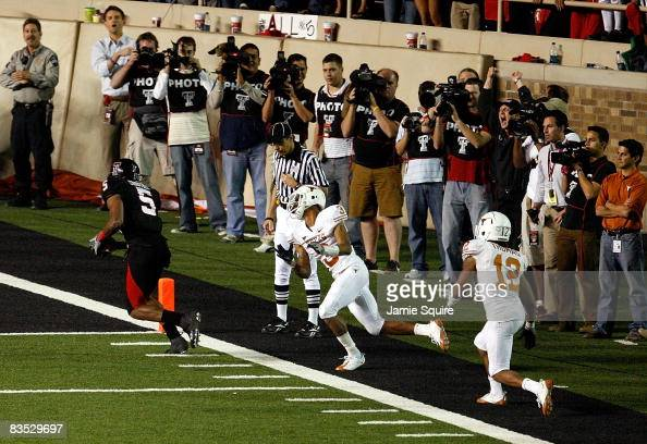 Michael Crabtree of the Texas Tech Red Raiders carries the ball into the end zone to score the winning touchdown during the game against the Texas...
