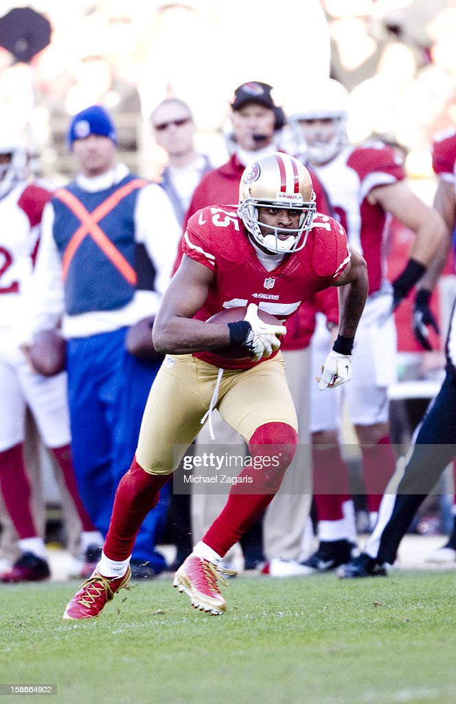 Michael Crabtree #15 runs after making a reception of the San Francisco 49ers during the game against the Arizona Cardinals at Candlestick Park on December 30, 2012 in San Francisco, California. The 49ers defeated the Cardinals 27-13.