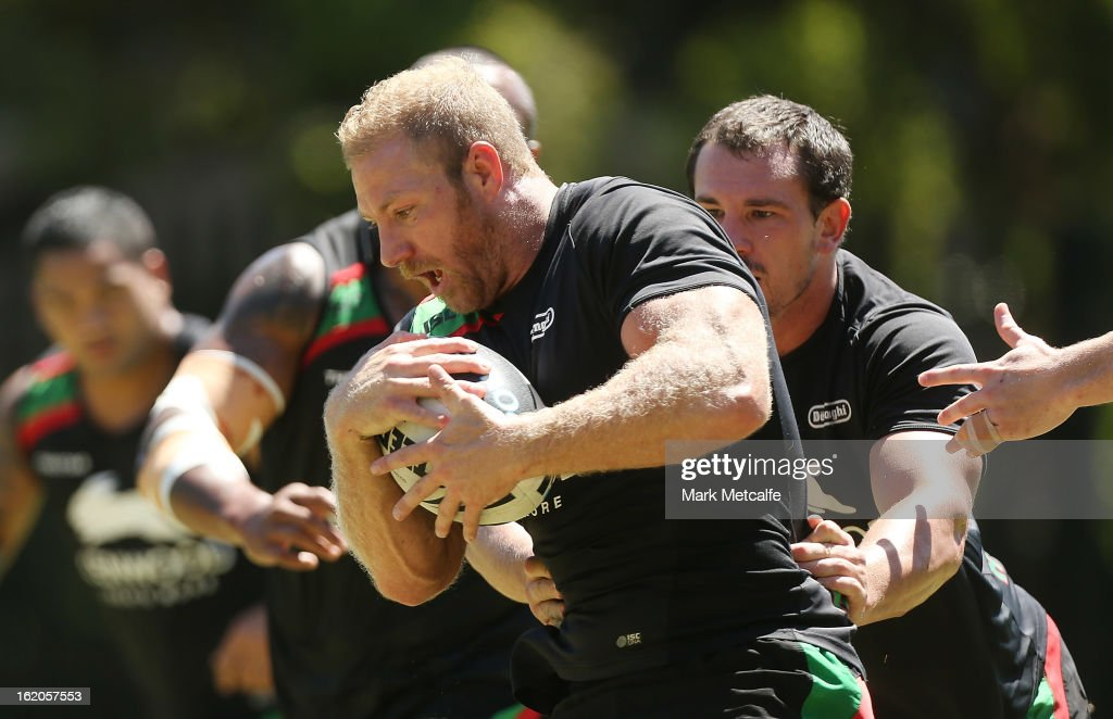 Michael Crocker is tackled during a South Sydney Rabbitohs NRL training session at the National Centre for Indigenous Excellence on February 19, 2013 in Sydney, Australia.