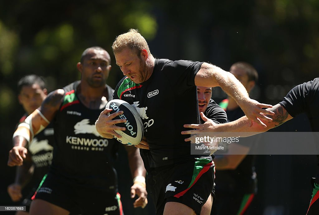 <a gi-track='captionPersonalityLinkClicked' href=/galleries/search?phrase=Michael+Crocker&family=editorial&specificpeople=171687 ng-click='$event.stopPropagation()'>Michael Crocker</a> is tackled during a South Sydney Rabbitohs NRL training session at the National Centre for Indigenous Excellence on February 19, 2013 in Sydney, Australia.