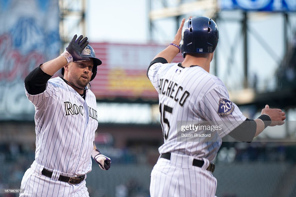 Michael Cuddyer #3 and Jordan Pacheco #15 of the Colorado Rockies celebrate a first-inning Cuddyer home run against the Tampa Bay Rays at Coors Field on May 3, 2013 in Denver, Colorado. The Rockies led the Rays 2-0 after one inning.