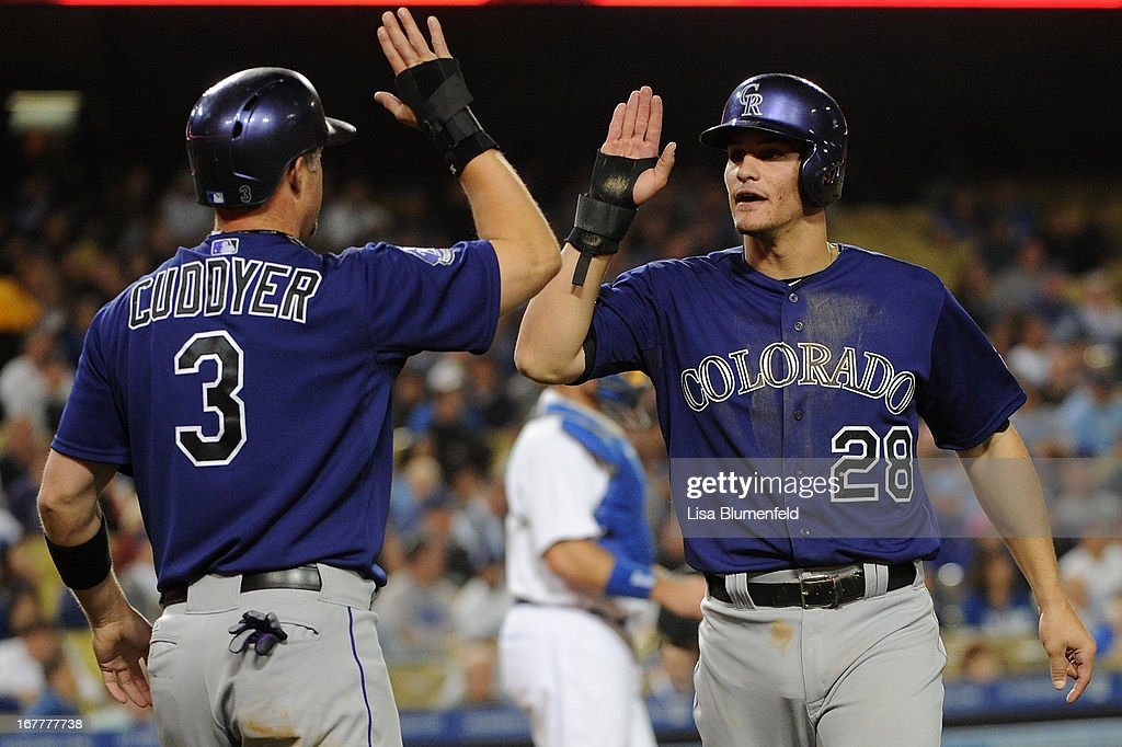 Michael Cuddyer #3 and Nolan Arenado #28 of the Colorado Rockies celebrate after scoring in the fourth inning against the Los Angeles Dodgers at Dodger Stadium on April 29, 2013 in Los Angeles, California.