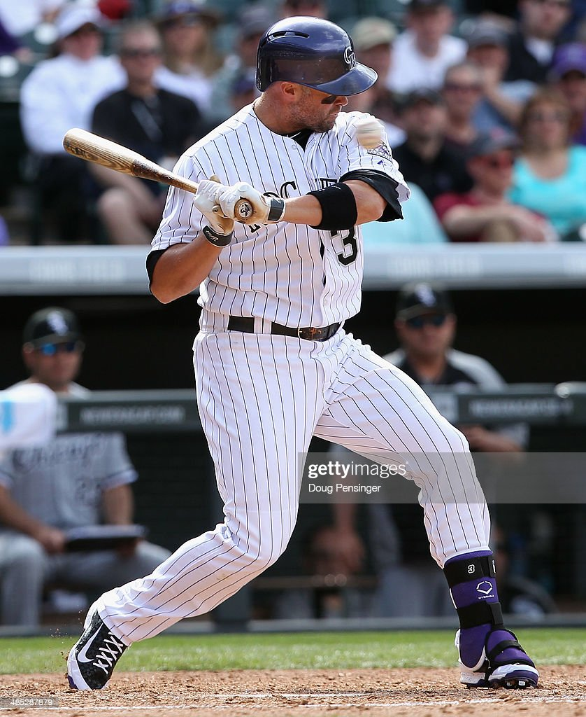 <a gi-track='captionPersonalityLinkClicked' href=/galleries/search?phrase=Michael+Cuddyer&family=editorial&specificpeople=208127 ng-click='$event.stopPropagation()'>Michael Cuddyer</a> #3 of the Colorado Rockies avoids a high inside pitch as he takes an at bat against the Chicago White Sox during Interleague play at Coors Field on April 9, 2014 in Denver, Colorado. The Rockies defeated the White Sox 10-4.