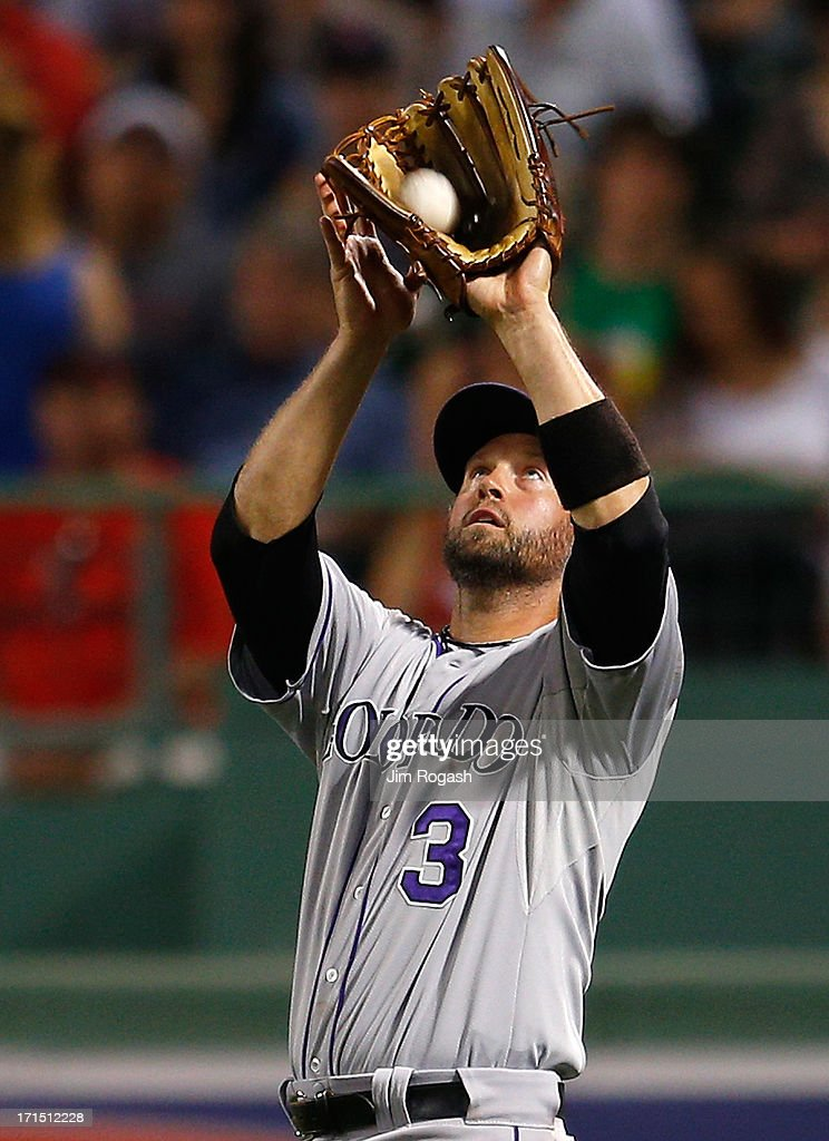 <a gi-track='captionPersonalityLinkClicked' href=/galleries/search?phrase=Michael+Cuddyer&family=editorial&specificpeople=208127 ng-click='$event.stopPropagation()'>Michael Cuddyer</a> #3 of the Colorado Rockies catches a fly ball from the bat of Dustin Pedroia #15 of the Boston Red Sox in the 5th inning at Fenway Park on June 25, 2013 in Boston, Massachusetts.