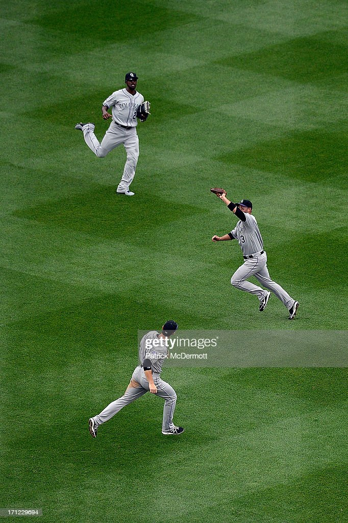 <a gi-track='captionPersonalityLinkClicked' href=/galleries/search?phrase=Michael+Cuddyer&family=editorial&specificpeople=208127 ng-click='$event.stopPropagation()'>Michael Cuddyer</a> #3 of the Colorado Rockies catches a fly ball hit by Jeff Kobernus #26 of the Washington Nationals in the third inning during a game at Nationals Park on June 23, 2013 in Washington, DC.