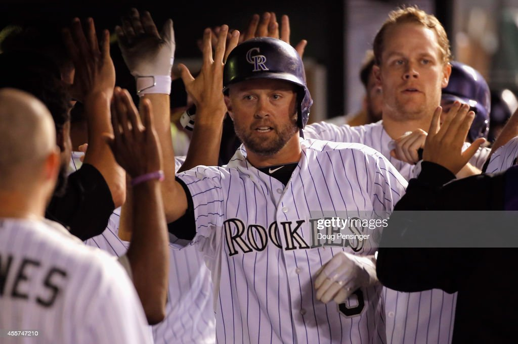 Michael Cuddyer #3 of the Colorado Rockies celebrates his grand slam home run of of Eury De La Rosa #56 of the Arizona Diamondbacks to give the Rockies a 11-2 lead in the sixth inning at Coors Field on September 19, 2014 in Denver, Colorado.