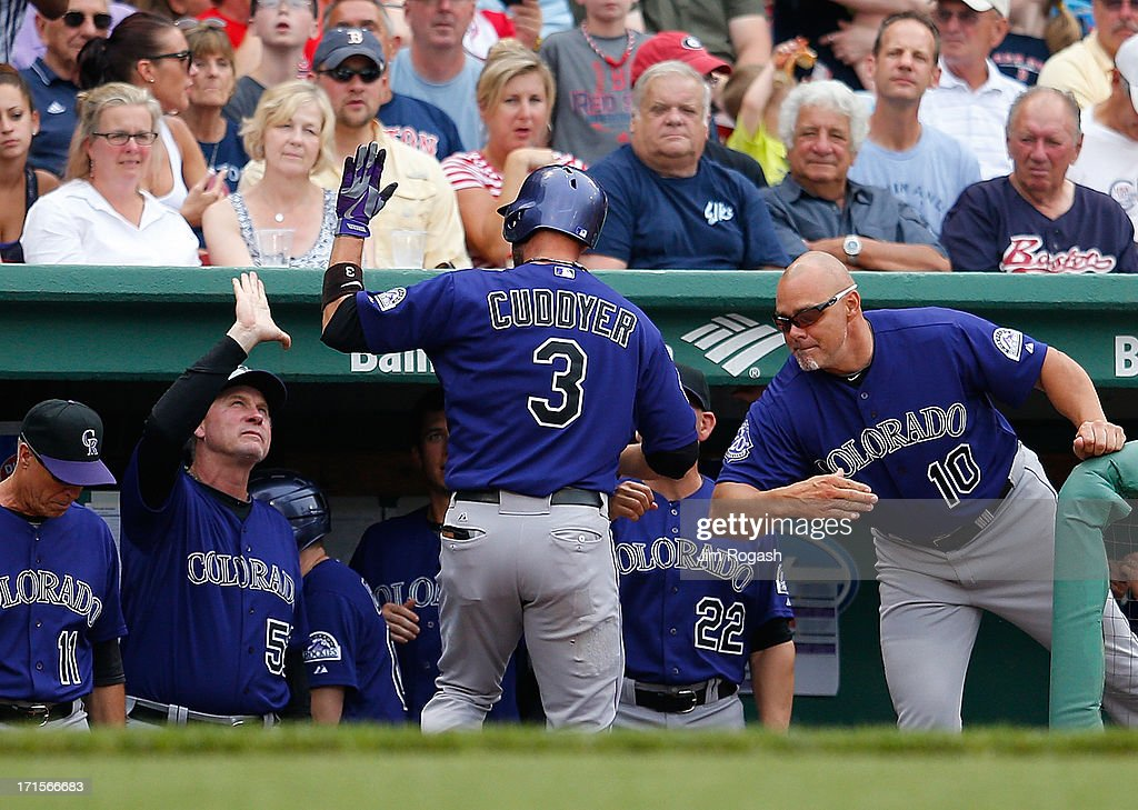 Michael Cuddyer #3 of the Colorado Rockies celebrates with teammates after he hit the first of two home runs against the Boston Red Sox at the plate in the 6th inning at Fenway Park on June 26, 2013 in Boston, Massachusetts.