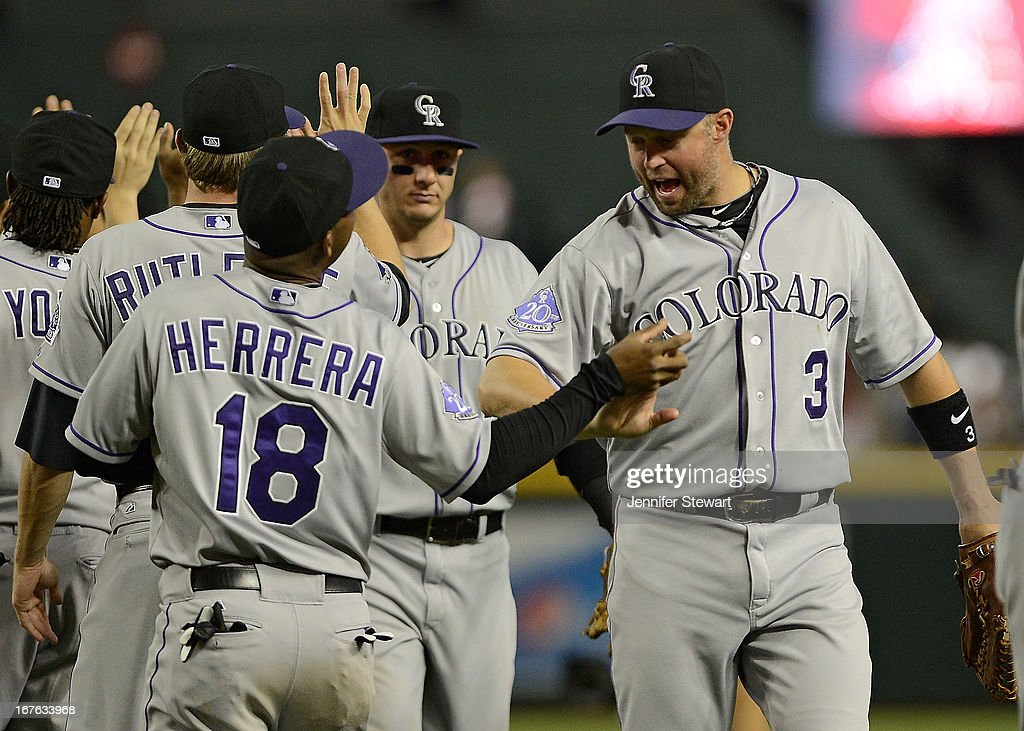 <a gi-track='captionPersonalityLinkClicked' href=/galleries/search?phrase=Michael+Cuddyer&family=editorial&specificpeople=208127 ng-click='$event.stopPropagation()'>Michael Cuddyer</a> #3 of the Colorado Rockies celebrates with teammates after defeating the Arizona Diamondbacks in the ninth inning at Chase Field on April 26, 2013 in Phoenix, Arizona. The Rockies defeated the Diamondbacks 6 to 3.