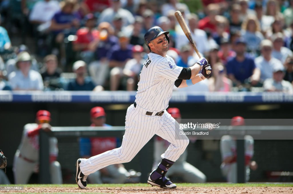 <a gi-track='captionPersonalityLinkClicked' href=/galleries/search?phrase=Michael+Cuddyer&family=editorial&specificpeople=208127 ng-click='$event.stopPropagation()'>Michael Cuddyer</a> #3 of the Colorado Rockies doubles in the seventh inning of a game against the Philadelphia Phillies at Coors Field on June 16, 2013 in Denver, Colorado. The Rockies beat the Phillies 5-2.