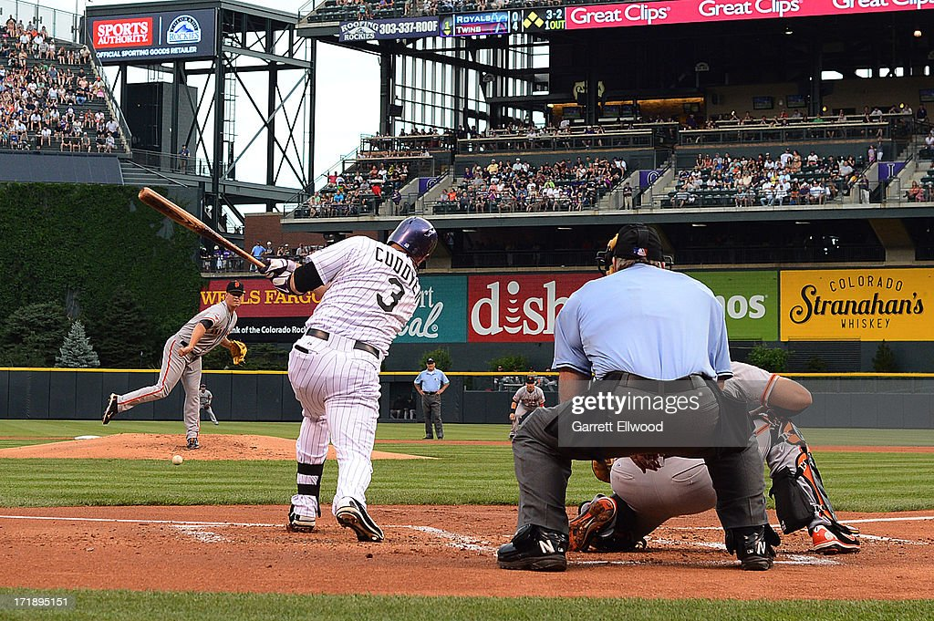 <a gi-track='captionPersonalityLinkClicked' href=/galleries/search?phrase=Michael+Cuddyer&family=editorial&specificpeople=208127 ng-click='$event.stopPropagation()'>Michael Cuddyer</a> #3 of the Colorado Rockies gets a hit in the first inning against the San Francisco Giants to extend his hitting streak to 26 games during the game at Coors Field on June 29, 2013 in Denver, Colorado.